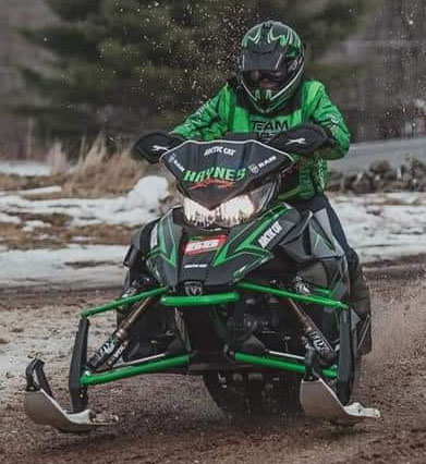haynes racing green decal on snowmobile